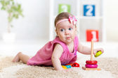 Funny child playing with color toy indoor — Stock Photo