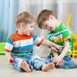 Children brothers playing together in nursery  or day care center — Stock Photo #77037313