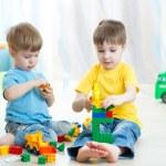 Cute little kids play with building bricks in preschool — Stock Photo #77039209