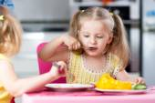 Little children eating food at daycare — Stock Photo