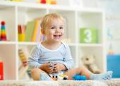 Little child boy plays with toys animals — Stock Photo