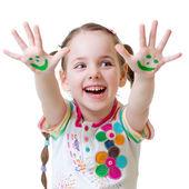 Criança sorridente mostra mãos pintadas — Fotografia Stock
