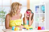 Woman and kid have fun pastime making handcraft at home — Stock Photo