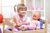 Child Playing Doctor with doll Toy — Stock Photo