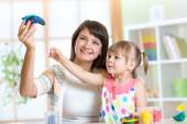 Woman teaches child handcraft at kindergarten or playschool — Stock Photo