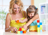 Mother with his child girl play together — Stock Photo