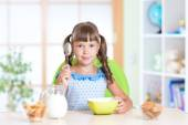 Kid eating healthy food at home — Stock Photo