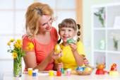 Mother and child daughter painted  Easter eggs — Stock Photo