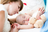 Happy mother cuddling her newborn baby — Stock Photo