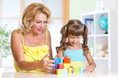 Mom with her daughter child play together — Stock Photo