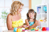 Child with mom making by hands — Stock Photo