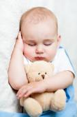 Cute sleeping baaby with teddy bear — Stock Photo