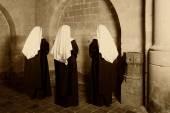 Three nuns in church — Stock Photo