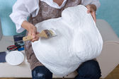 Painting a belly cast — Stock Photo