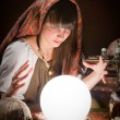 Fortune-teller and a crystal ball — Stock Photo #54603651