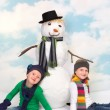 Snowman and girls — Stock Photo #55046103