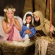 Little angel in nativity scene — Stock Photo #55046427