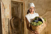 Vintage girls with fruit basket — Stock Photo