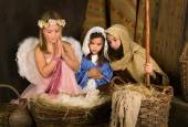 Little angel in nativity scene — Stock Photo