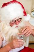 Santa Claus putting his teeth in — Stock Photo
