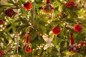 Santa puppets in christmas tree — Stock Photo