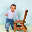 African baby boy trying to stand — Stock Photo #58572755