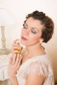 1920s woman with perfume — Stock Photo