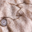 Antique watch on lace — Stock Photo #59069423