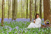 Long hair woman in bluebells forest — Стоковое фото
