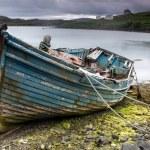 Weathered boat on beach — Stok fotoğraf #63653483