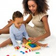 Toddler playing with blocks — Stock Photo #64233141