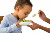 African boy refusing his vegetables — Stock Photo