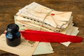 Feather ink and old letters — Stock Photo