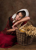 Victorian peasant girl with basket — Stock Photo