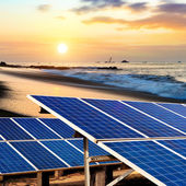 Solar panels on the beach — Stock Photo