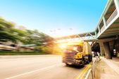 Trucks and viaduct — Stock Photo