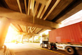 Trucks and viaduct — Stock Photo