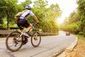 Man on road bike — Stock Photo