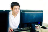 Man in computer operation — Stock Photo