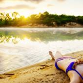 Girl lying on the beach — Stock Photo