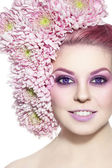 Woman with stylish violet make-up and flowers — Stock Photo