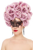 Woman with flower wig and venetian mask — Stock Photo