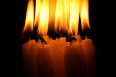 Candles burn in darkness — Stock Video