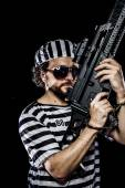 Man holding a machine gun — Stock Photo