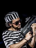 Man holding a machine gun — Stock Photo