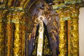 Irgin Mary in gilded chapel — Stock Photo