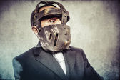 Dangerous business man with iron mask — ストック写真