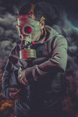 Armed man with gas mask — Stock Photo