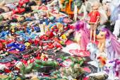 Lot of antique dolls and retro toys — Stock Photo