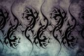 Tattoo design over grey background — 图库照片